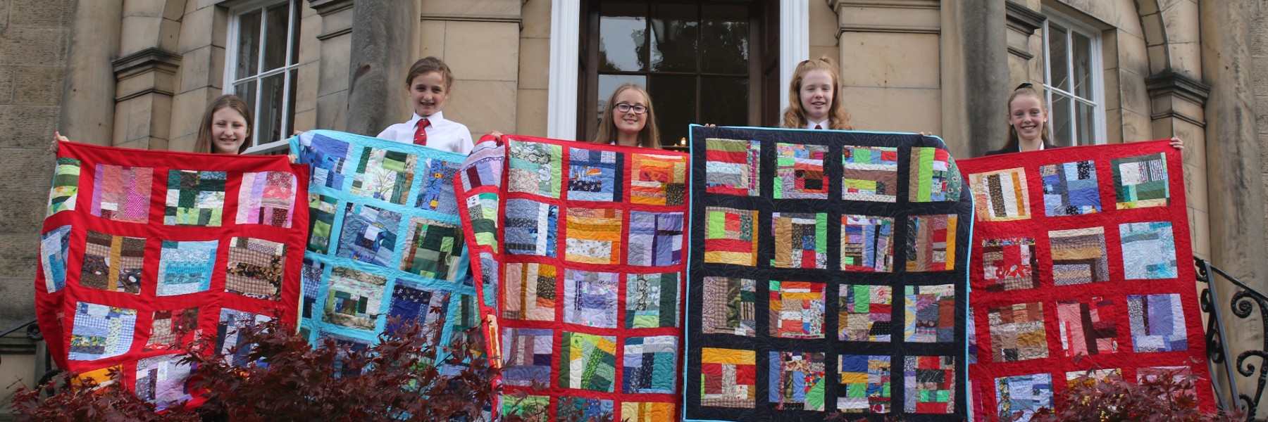 MES students with quilts for project linus