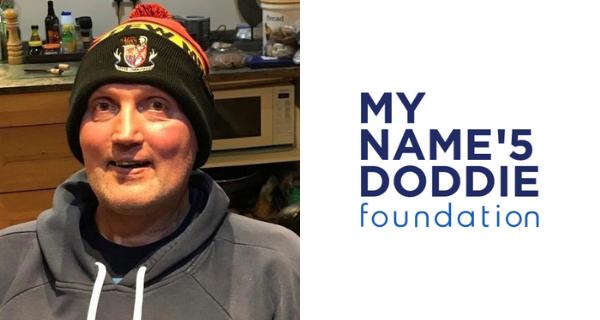 Doddie Weir wearing SMC hat