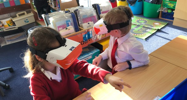 Children use VR headsets