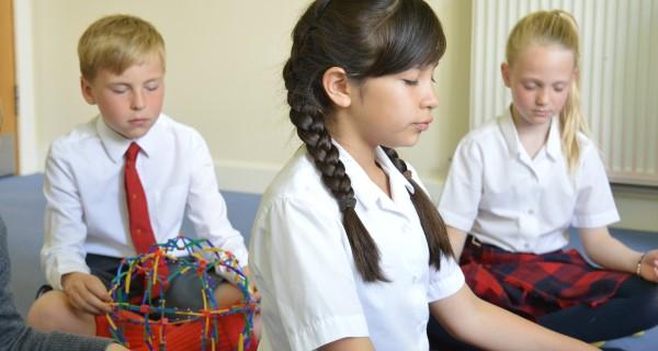 children practice mindfulness in school